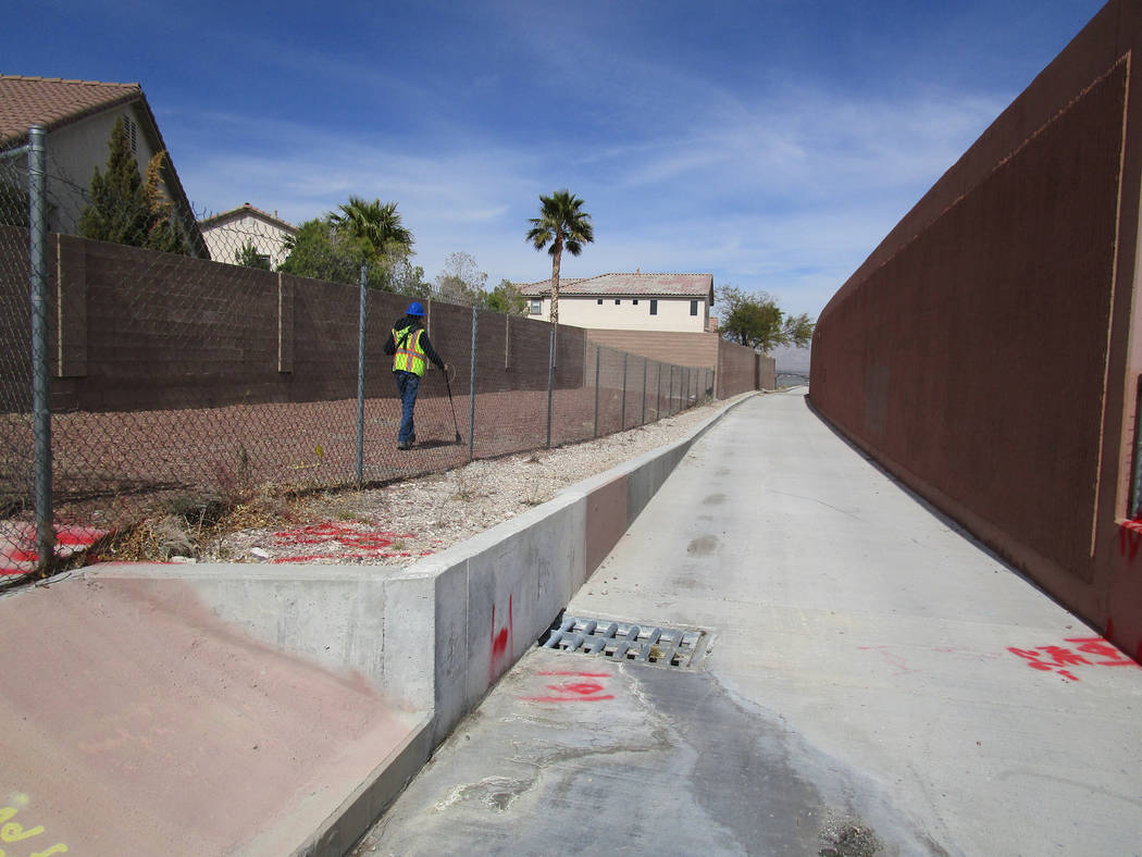 A utility worker makes his rounds adjacent to a newly opened stretch of the Western Beltway Trail in northwest Las Vegas on Thursday, March 8, 2018. The trail is now open between Alexander Road an ...