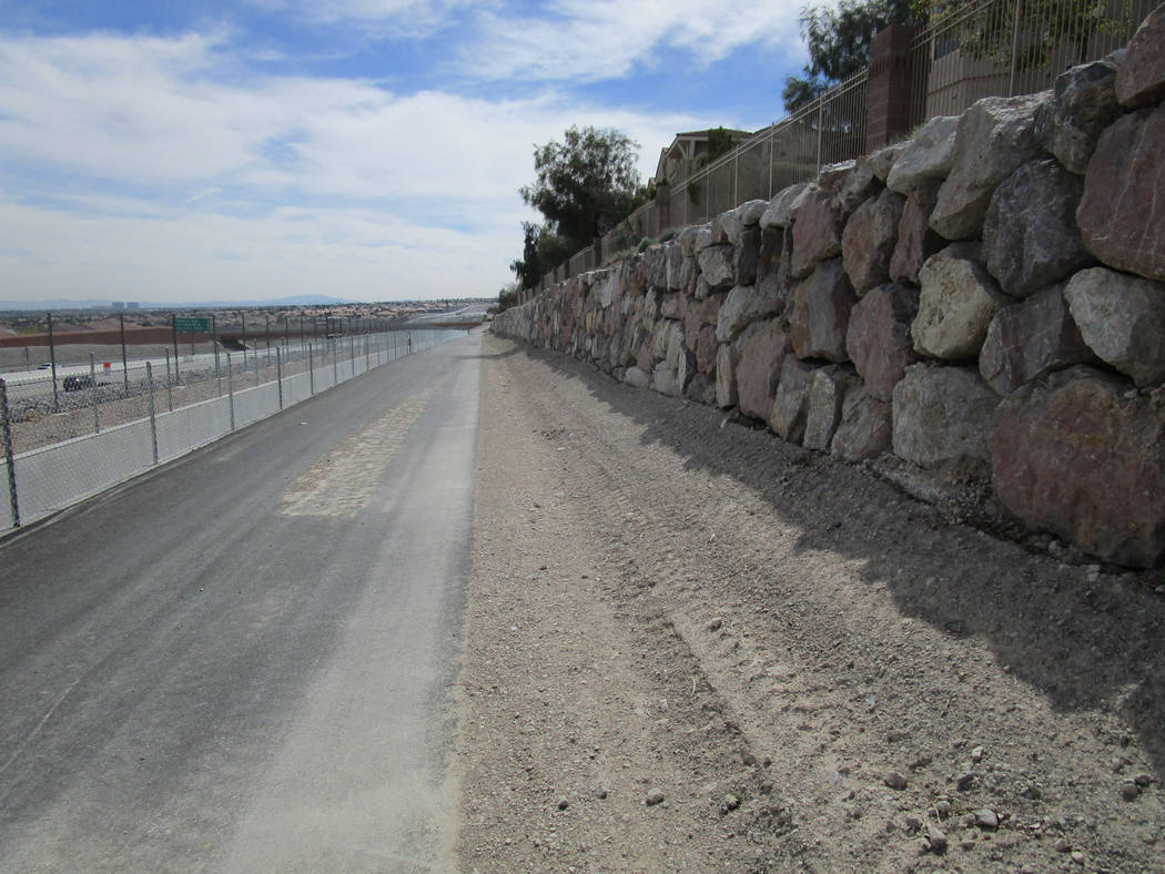 A rock wall borders a newly opened stretch of the Western Beltway Trail in northwest Las Vegas on Thursday, March 8, 2018. The trail is now open between Alexander Road and Centennial Parkway. (Gre ...