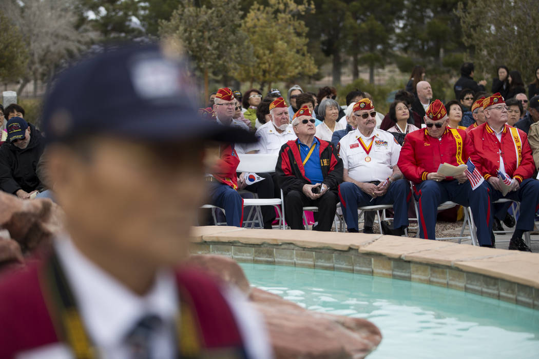 People attend the unveiling ceremony for a Korean War memorial monument at the Southern Nevada Veterans Memorial Cemetery in Boulder City, Saturday, March 3, 2018. Erik Verduzco Las Vegas Review-J ...