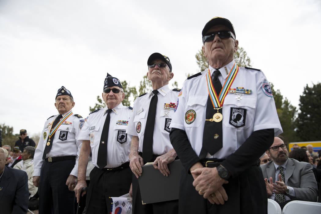 Korean War veterans from left, Henry Sawicki, Larry Kohlieber, Stan Croonquist, and Don McCarty, are recognized during the unveiling ceremony for a Korean War memorial monument at the Southern Nev ...