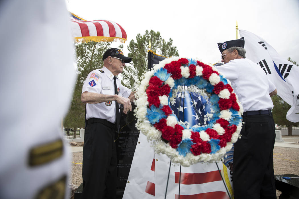 Korean War veterans Stan Croonquist, left, and Lee Mowery during the unveiling ceremony for a Korean War memorial monument at the Southern Nevada Veterans Memorial Cemetery in Boulder City, Saturd ...