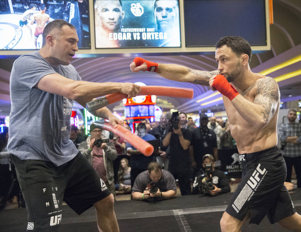 Frankie Edgar, right, the number two UFC featherweight contender, throws a right hook with sparring partner Mark Henry during open workouts leading up to Saturday's UFC 222 on Thursday, March 1, 2 ...