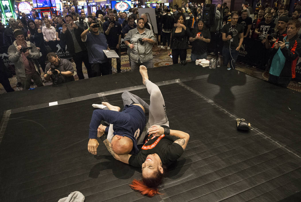 Cris Cyborg, right, UFC women's featherweight champion, warms up with coach and UFC icon B.J. Penn during open workouts leading up to Saturday's UFC 222 on Thursday, March 1, 2018, at the MGM Gran ...