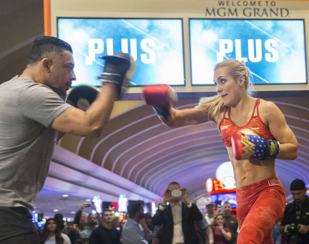 UFC women's featherweight contender Yana Kunitskaya, right, warms up during open workouts leading up to Saturday's UFC 222 on Thursday, March 1, 2018, at the MGM Grand hotel-casino, in Las Vegas.  ...