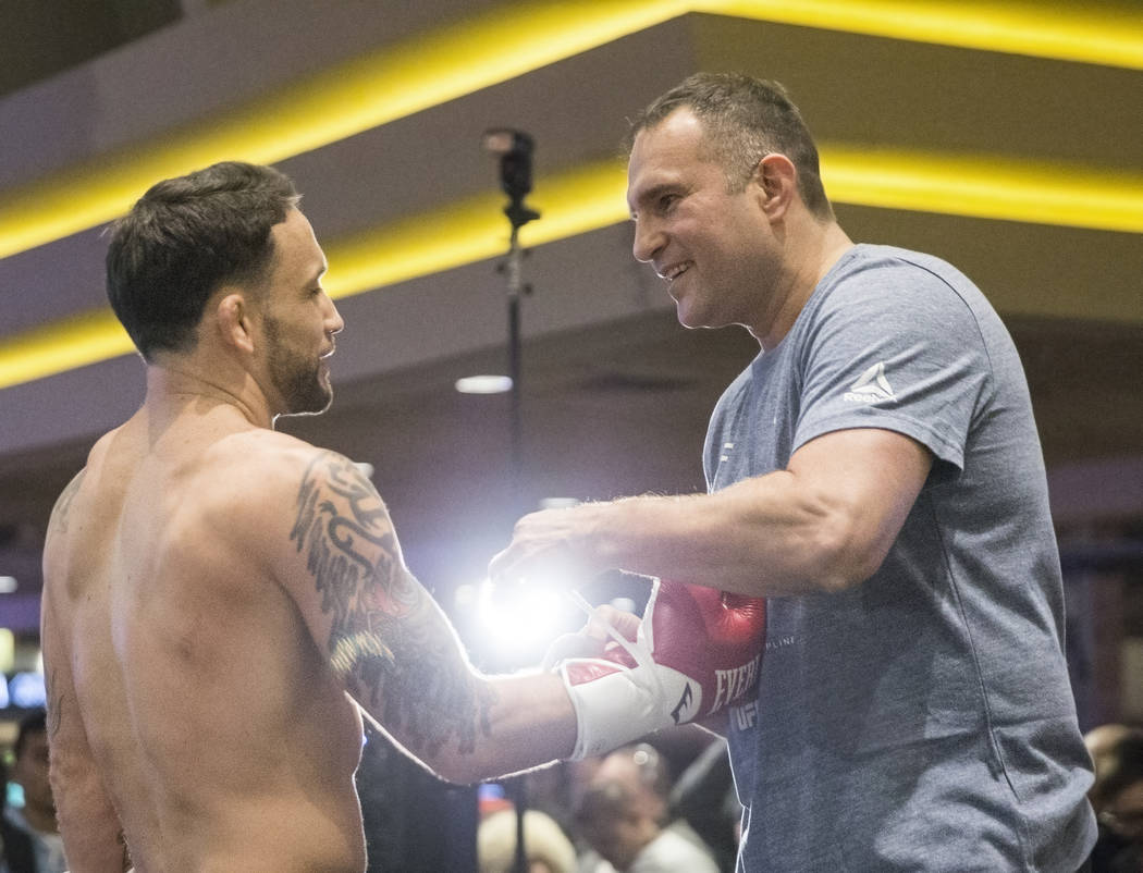 Frankie Edgar, left, the number two UFC featherweight contender, gets his wrists taped by sparring partner Mark Henry during open workouts leading up to Saturday's UFC 222 on Thursday, March 1, 20 ...
