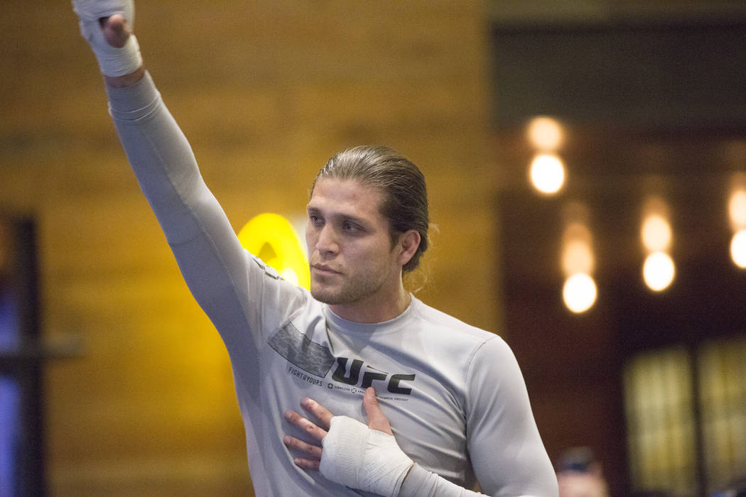 Brian Ortega, the number three UFC featherweight contender, salutes the crowd during open workouts leading up to Saturdays UFC 222 on Thursday, March 1, 2018, at the MGM Grand hotel-casino, in Las ...