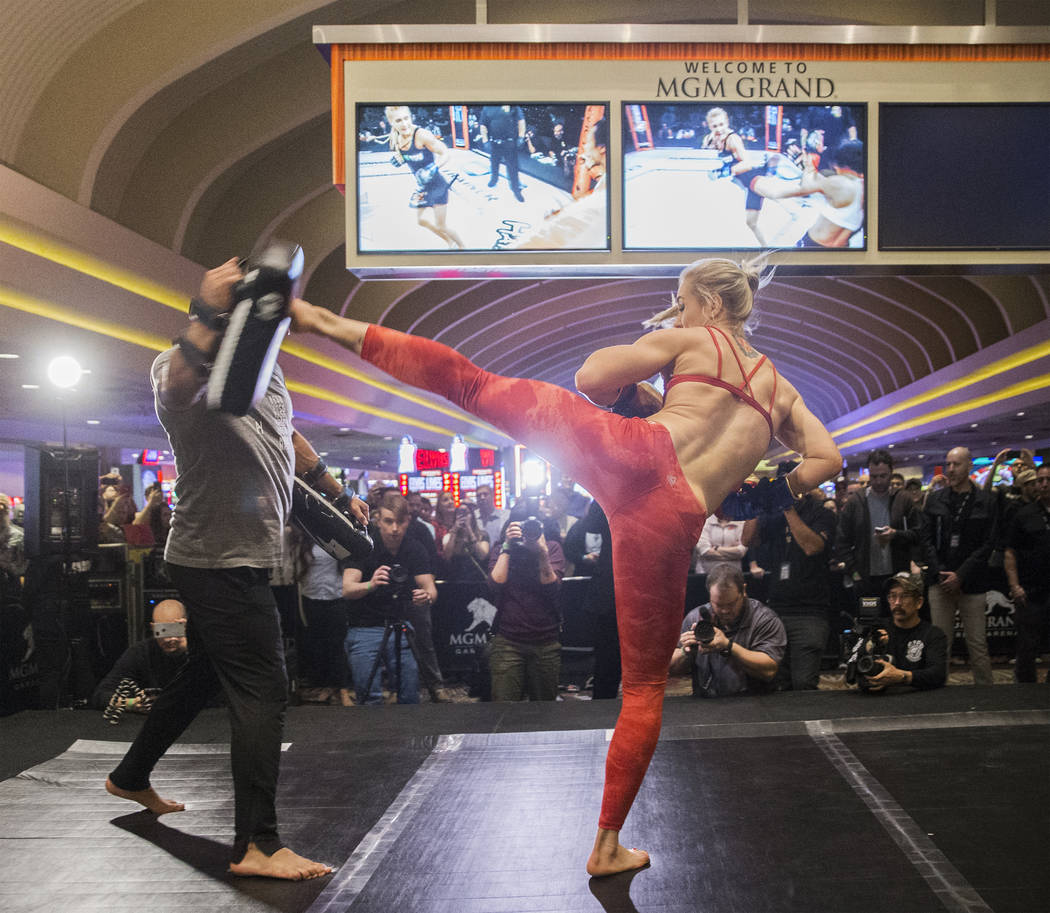 UFC women's featherweight contender Yana Kunitskaya, right, throws a kick during open workouts leading up to Saturday's UFC 222 on Thursday, March 1, 2018, at the MGM Grand hotel-casino, in Las Ve ...