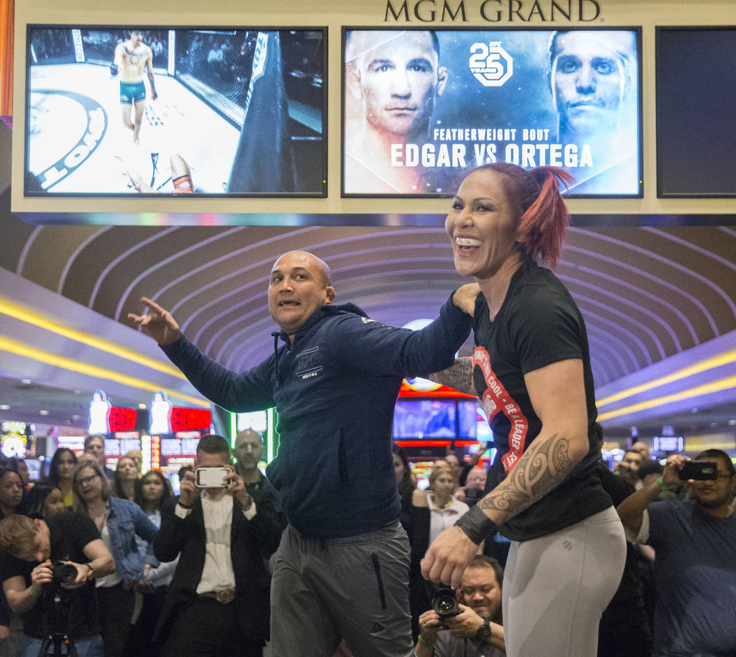 Cris Cyborg, right, UFC women's featherweight champion, shares a laugh with coach and UFC icon B.J. Penn after sparring during open workouts leading up to Saturday's UFC 222 on Thursday, March 1,  ...