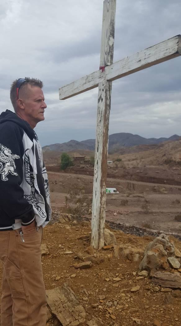 Roy McClellan prays at a cross in Whitney, Nevada, on Oct. 4, 2017. McClellan, a Las Vegas mass shooting survivor, killed himself in Pahrump on Nov. 17, 2017. (Denise McClellan)