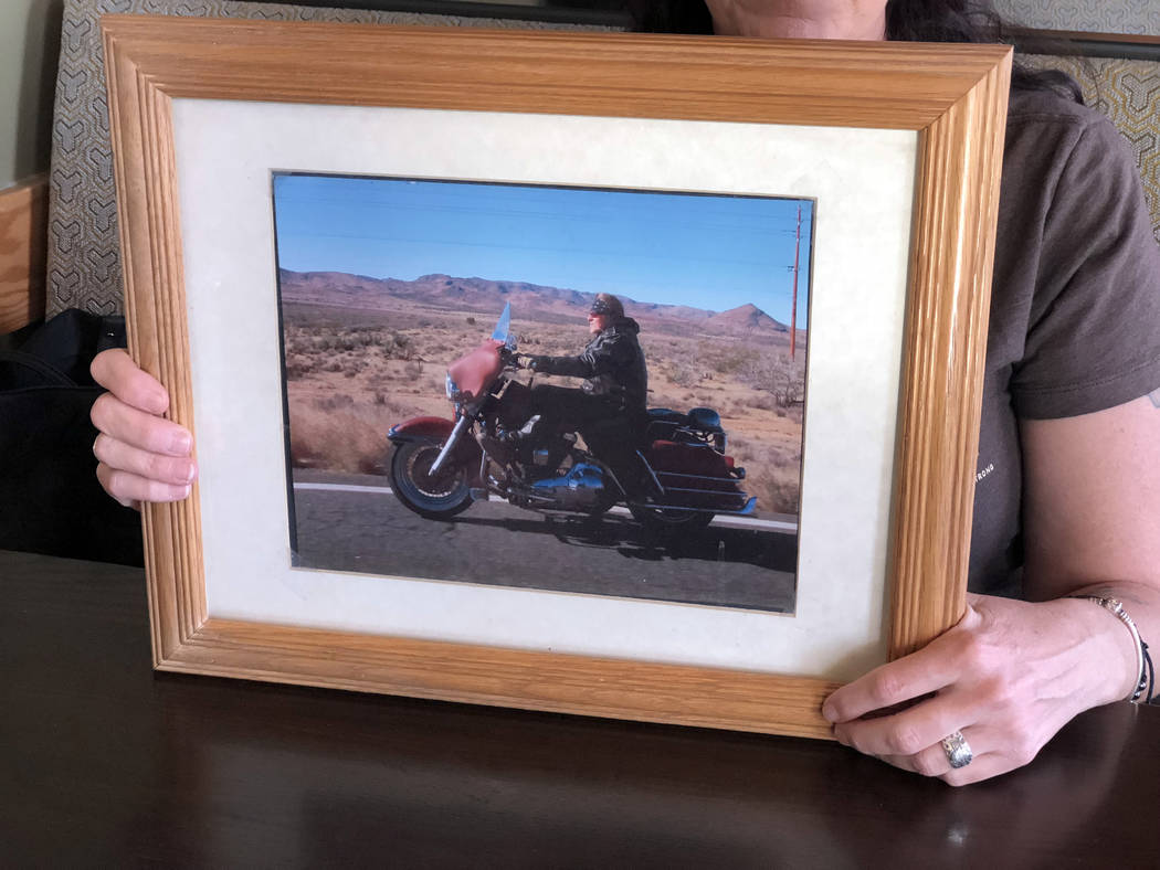 Denise McClellan holds her favorite photo of her husband, Roy, who on Nov. 17, 2017, killed himself in Pahrump, nearly two months after surviving the Las Vegas mass shooting. (Rio Lacanlale Las Ve ...