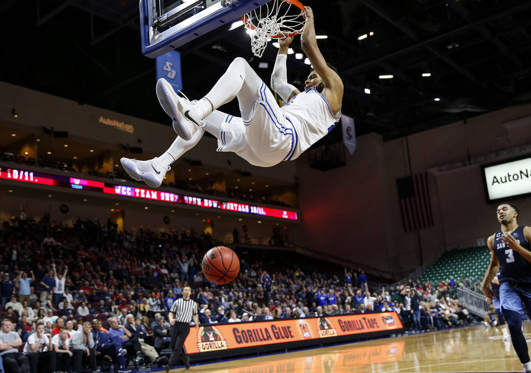 Brigham Young Cougars forward Yoeli Childs (23) dunks against the San Diego Toreros during the West Coast Conference Basketball Tournament quarterfinals at the Orleans Arena  in Las Vegas on Satur ...