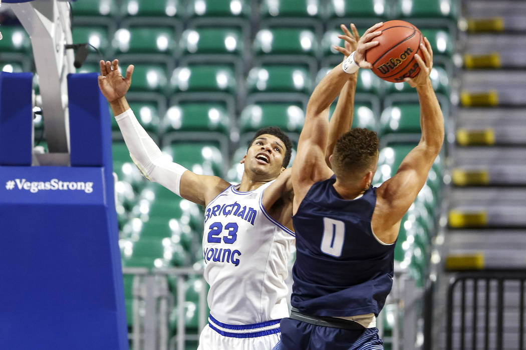 San Diego Toreros forward Isaiah Pineiro (0) takes the layup from Brigham Young Cougars forward Yoeli Childs (23) during the West Coast Conference Basketball Tournament quarterfinals at the Orlean ...
