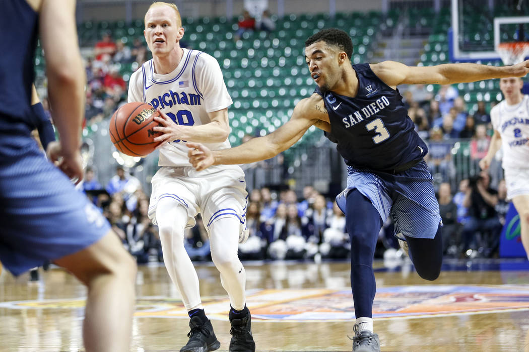 San Diego Toreros guard Olin Carter III (3) attempts to steal the ball from Brigham Young Cougars guard TJ Haws (30) during the West Coast Conference Basketball Tournament quarterfinals at the Orl ...