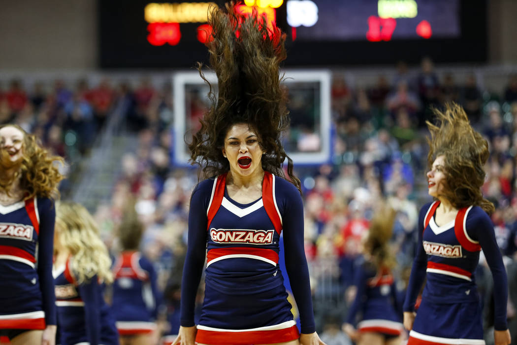 Gonzaga Bulldogs cheerleaders work the crowd on a time out during their game against the San Francisco Dons in the West Coast Conference basketball semifinal's at the Orleans Arena  Las Vegas on M ...