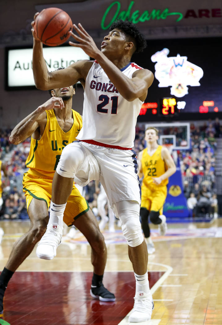 Gonzaga Bulldogs forward Rui Hachimura (21) drive the ball to the hoop against the San Francisco Dons during the West Coast Conference basketball semifinal's at the Orleans Arena  Las Vegas on Mon ...
