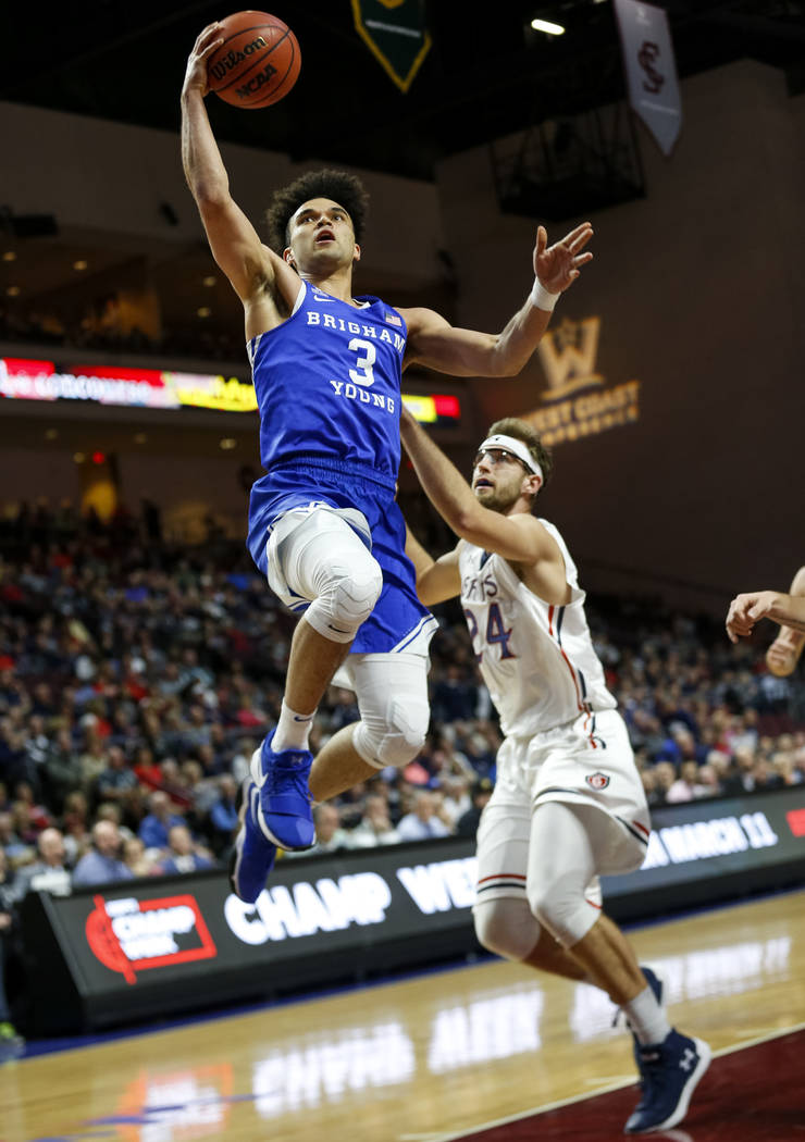 Brigham Young Cougars guard Elijah Bryant (3) goes up for a shot over St. Mary's Gaels forward Calvin Hermanson (24) during the West Coast Conference basketball semifinal's at the Orleans Arena  L ...