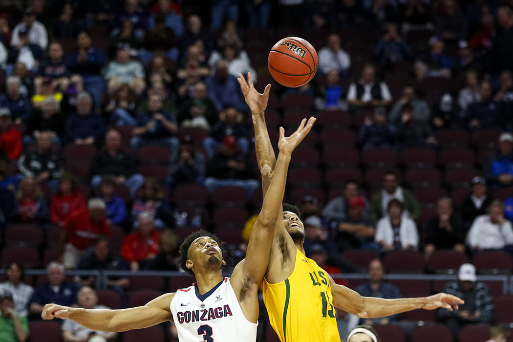 Gonzaga Bulldogs forward Johnathan Williams (3) and San Francisco Dons forward Nate Renfro (15) tip off during the West Coast Conference basketball semifinal's at the Orleans Arena  Las Vegas on M ...