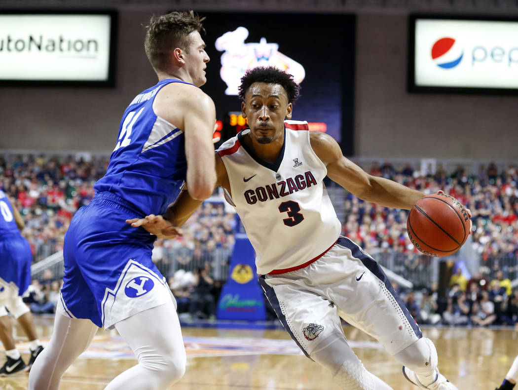 Gonzaga Bulldogs forward Johnathan Williams (3) drive the ball to the hoop as Brigham Young Cougars forward Luke Worthington (41) defends during the West Coast Conference championship game at the  ...