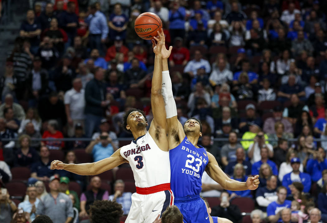 Gonzaga Bulldogs forward Johnathan Williams (3) and Brigham Young Cougars forward Yoeli Childs (23) tip off during the West Coast Conference championship game at the Orleans Arena in Las Vegas on  ...