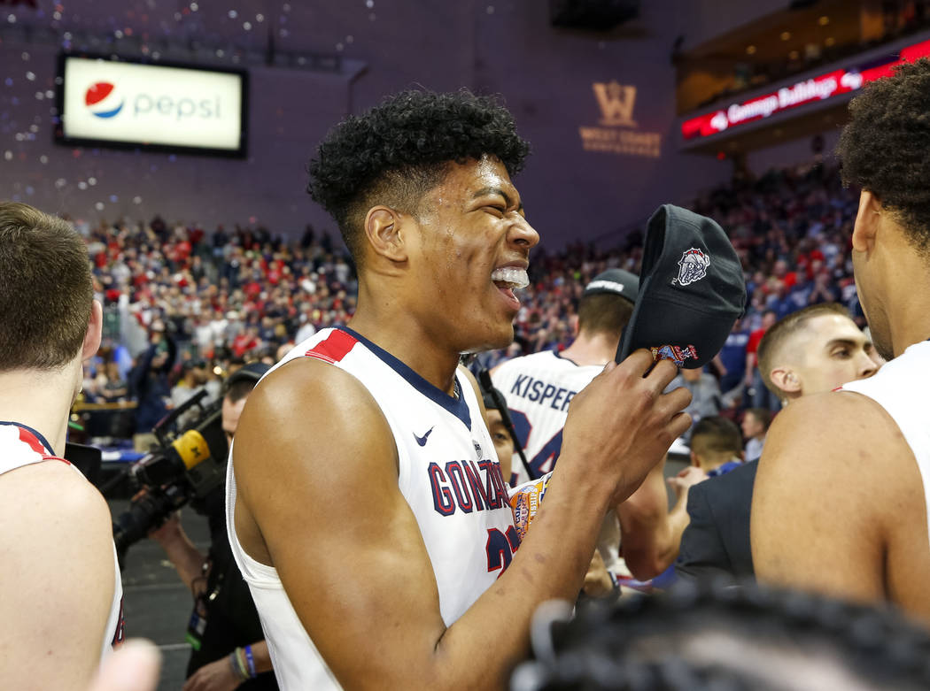 Gonzaga Bulldogs forward Rui Hachimura (21) celebrates  With fans a teammates after the Bulldogs defeated the BYU Cougars 74-54 in the West Coast Conference championship game at the Orleans Arena  ...