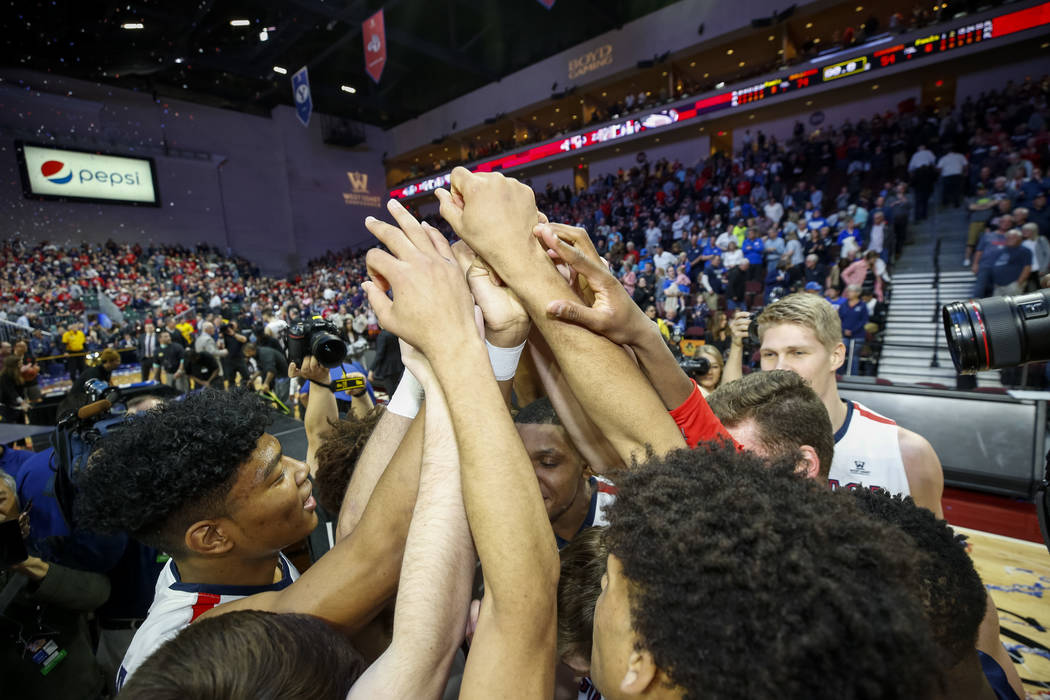 Gonzaga Bulldogs huddle after defeating the BYU Cougars 74-54 in the West Coast Conference championship game at the Orleans Arena in Las Vegas on Tuesday, March 6, 2018. Richard Brian Las Vegas Re ...