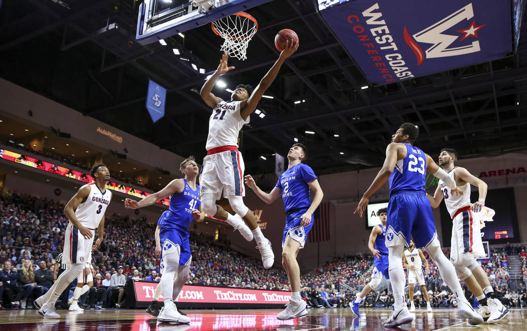 Gonzaga Bulldogs forward Rui Hachimura (21) makes a lay up against the Brigham Young Cougars during the West Coast Conference championship game at the Orleans Arena in Las Vegas on Tuesday, March  ...