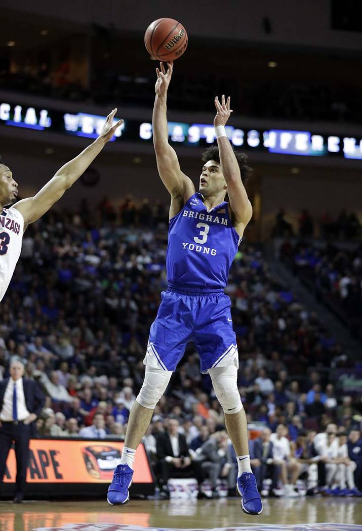Gonzaga's Johnathan Williams covers a shot from BYU's Elijah Bryant during the first half of the West Coast Conference tournament championship NCAA college basketball game Tuesday, March 6, 2018,  ...