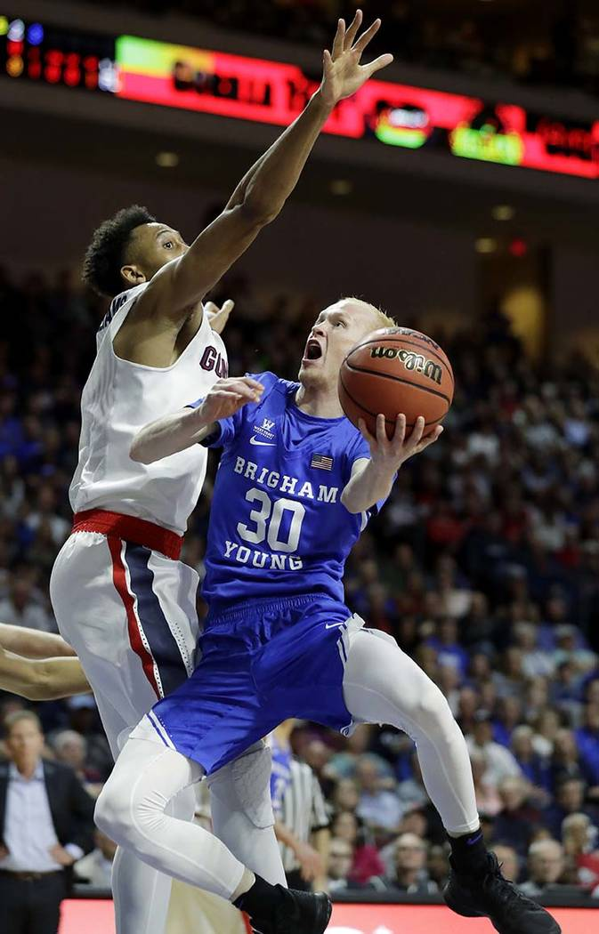 Gonzaga's Johnathan Williams covers a shot from BYU's TJ Haws during the first half of the West Coast Conference tournament championship NCAA college basketball game Tuesday, March 6, 2018, in Las ...
