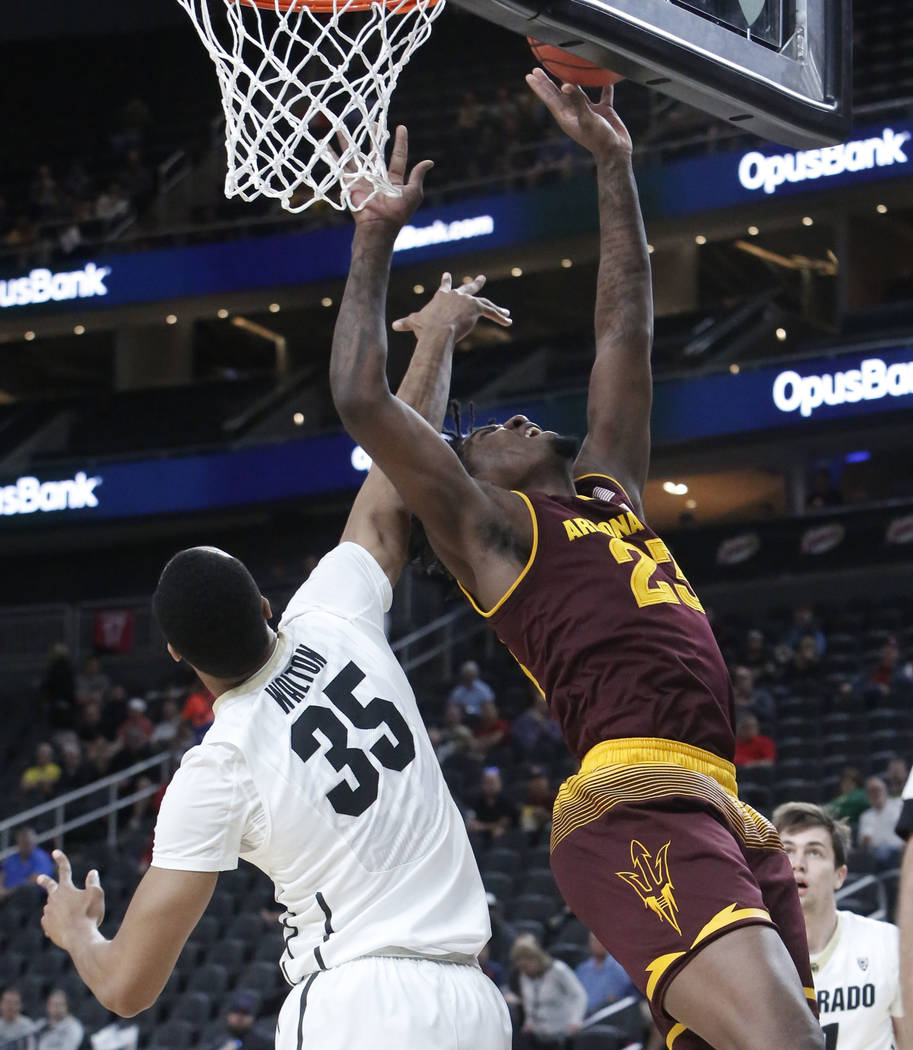 Colorado Buffaloes' Dallas Walton (35) and Arizona State's Romello White (23) jump for a rebound during an NCAA college basketball game in the first round of the Pac-12 tournament on Wednesday, Ma ...