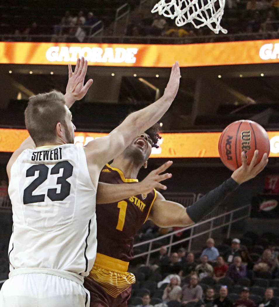 Colorado Buffaloes' Lucas Siewert (23) tries to block Arizona State's  Remy Martin (1) during an NCAA college basketball game in the first round of the Pac-12 tournament on Wednesday, March 7, 201 ...