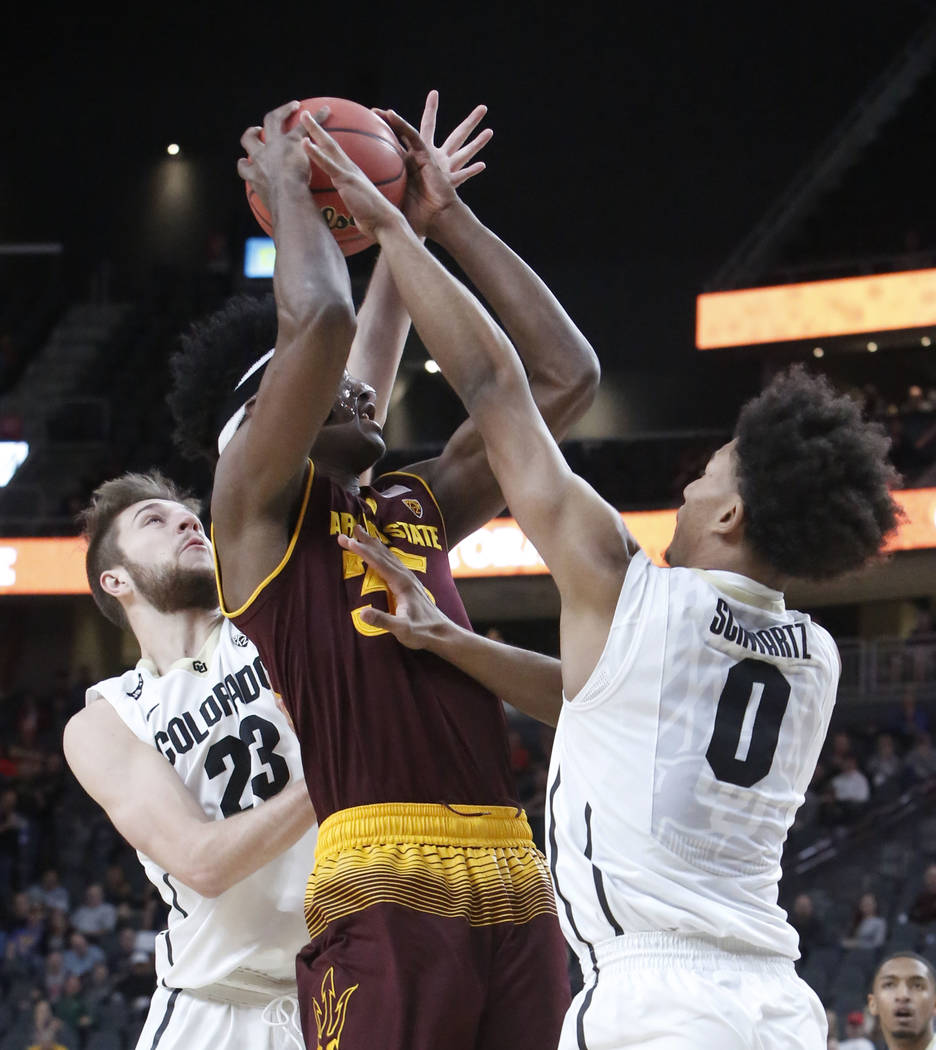Arizona State's  De'Quon Lake (35) tries to shoot between Colorado Buffaloes' Lucas Siewert (23) and D'Shawn Schwartz (0) during an NCAA college basketball game in the first round of the Pac-12 to ...
