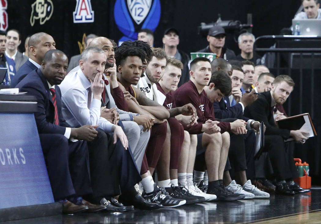 Arizona State head coach Bobby Hurley, second from left, watch the last minute of play during an NCAA college basketball game against Colorado Buffaloes in the first round of the Pac-12 tournament ...