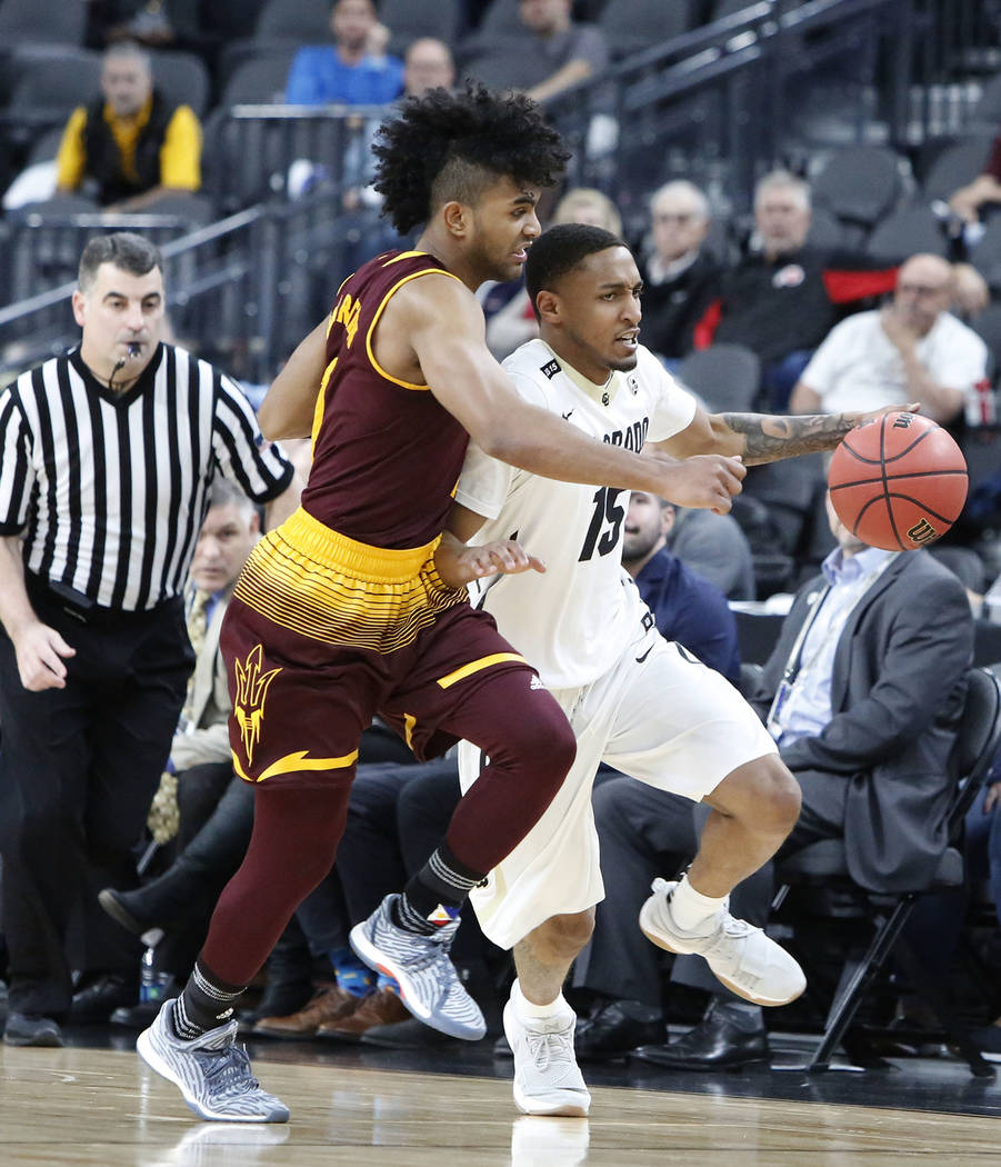 Arizona State's Remy Martin (1) defends Colorado Buffaloes' Dominique Collier (15), right, during an NCAA college basketball game in the first round of the Pac-12 tournament on Wednesday, March 7, ...