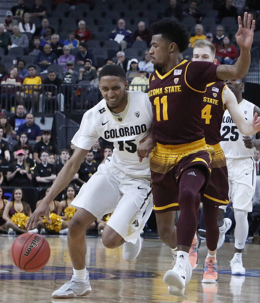 Arizona State's Shannon Evans II (11) defends Colorado Buffaloes' Dominique Collier (15) during an NCAA college basketball game in the first round of the Pac-12 tournament on Wednesday, March 7, 2 ...