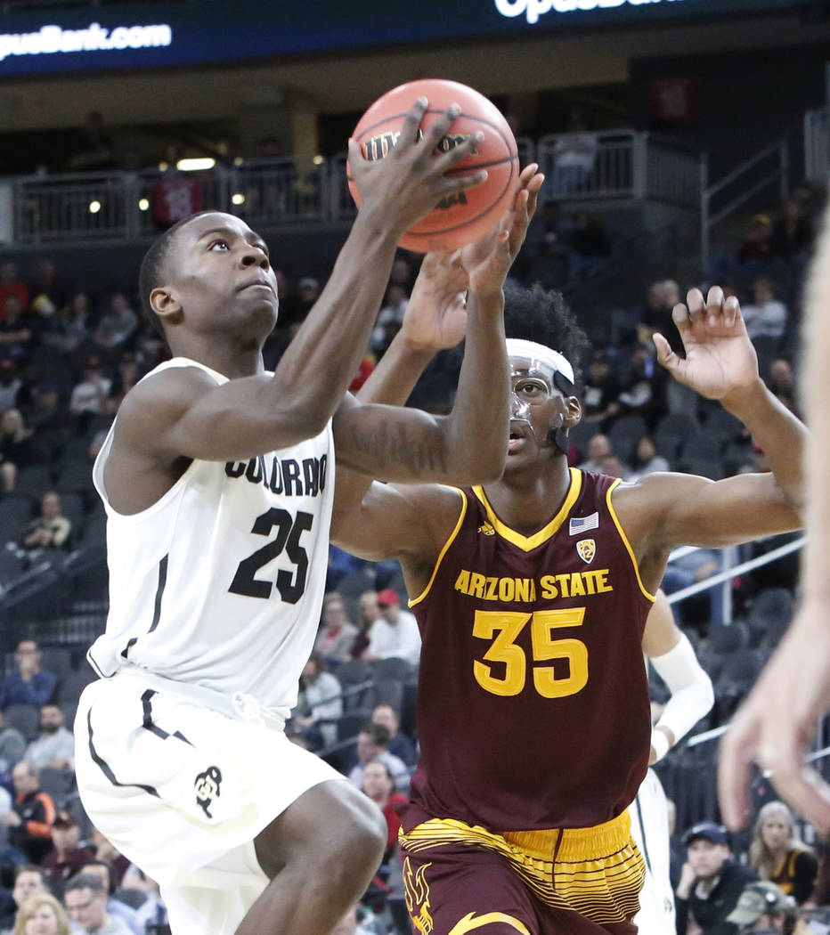 Colorado Buffaloes' McKinley Wright IV (25) drives past Arizona State's De'Quon Lake (35) during an NCAA college basketball game in the first round of the Pac-12 tournament on Wednesday, March 7,  ...