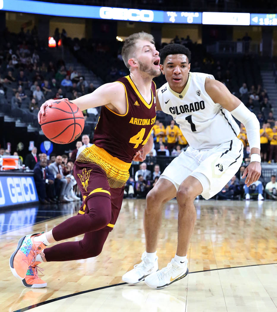 Arizona State's  Kodi Justice (44) drives past Colorado Buffaloes' Tyler Bey (1) during an NCAA college basketball game in the first round of the Pac-12 tournament on Wednesday, March 7, 2018, in  ...