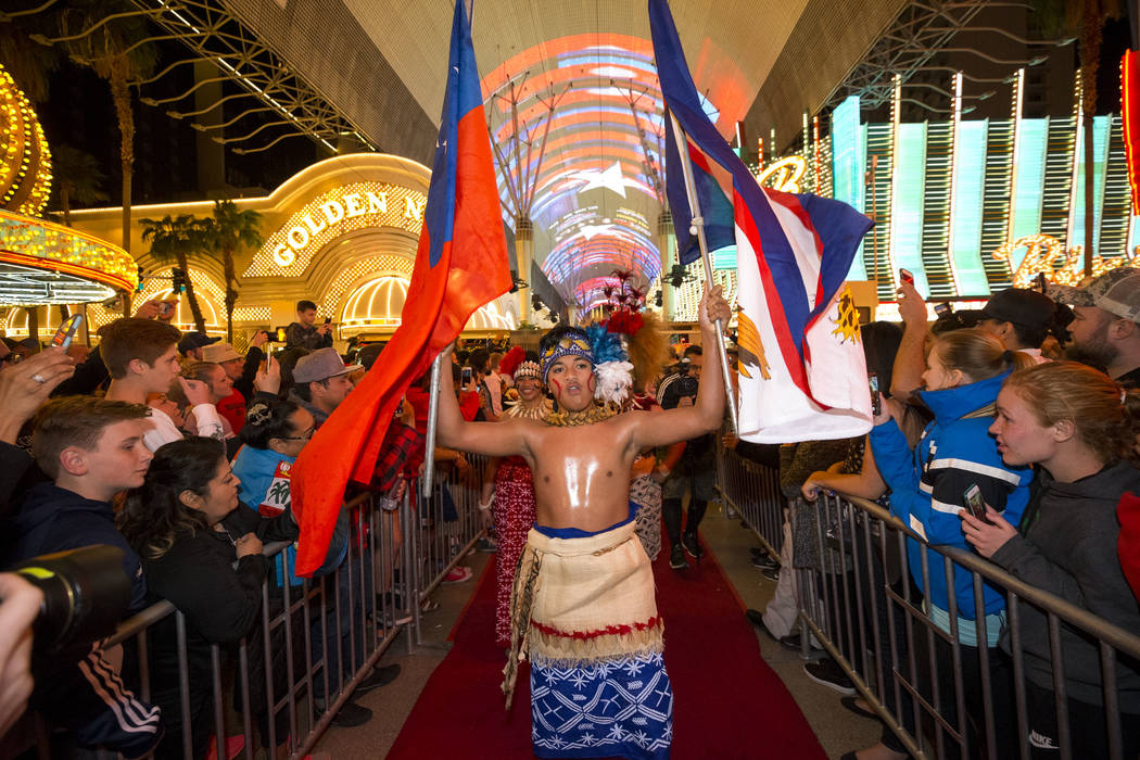 Flag-bearer Malachi Belesasa lead the Samoan Rugby team during the Parade of Nations at the Fremont Street Experience in downtown in Las Vegas on Thursday, March 1, 2018. Richard Brian Las Vegas R ...