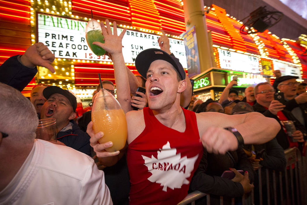 Canadian rugby fans cheer on their team during the Parade of Nations at the Fremont Street Experience in downtown in Las Vegas on Thursday, March 1, 2018. Richard Brian Las Vegas Review-Journal @v ...