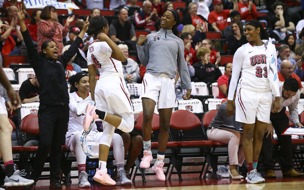 UNLV Lady Rebels guard Kennedy Wharton (0), center Rodjanae Wade (24) and forward Jordyn Bell (23) react as their team leads against Utah State during the second half of a basketball game at the C ...