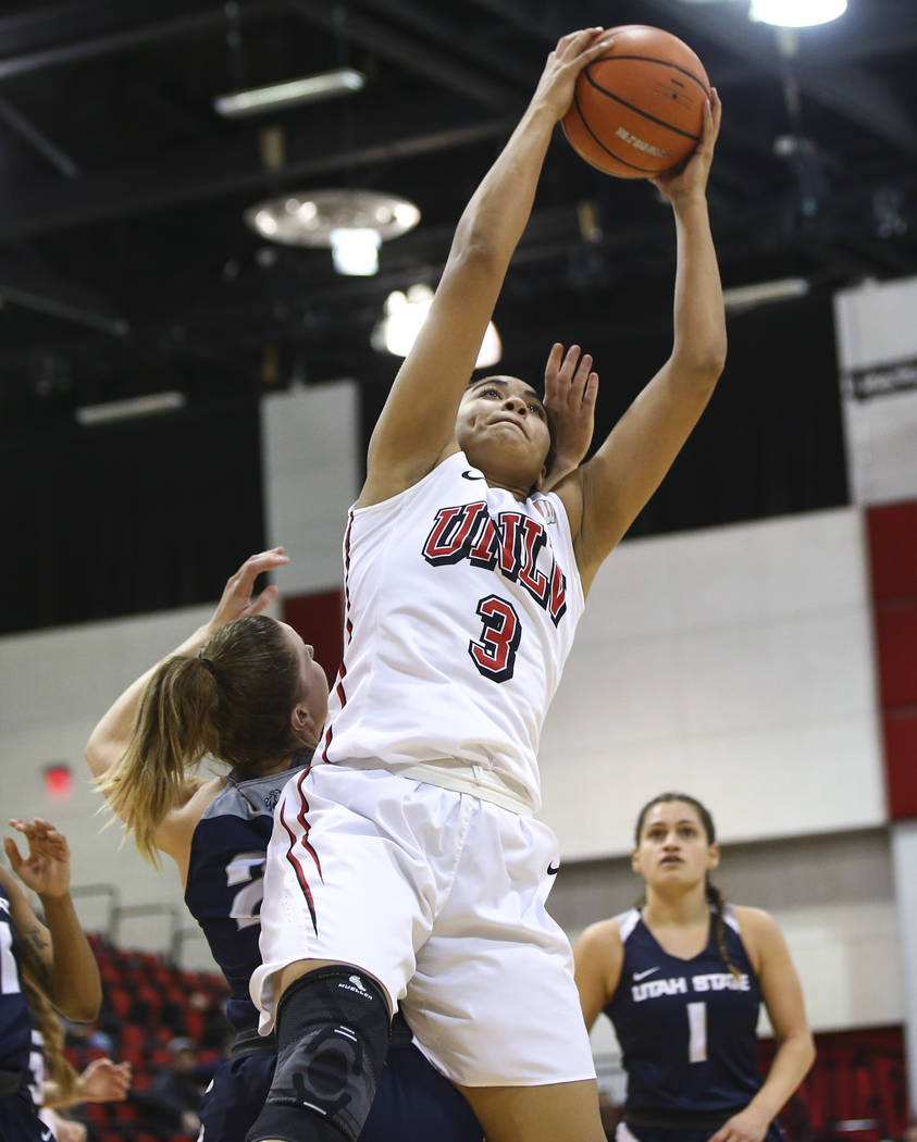 UNLV Lady Rebels forward/center Paris Strawther (3) gets a rebound over Utah State Aggies guard Rachel Brewster (22) during the second half of a basketball game at the Cox Pavilion in Las Vegas on ...