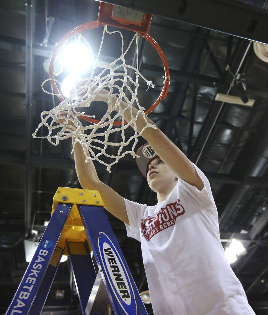 UNLV Lady Rebels guard Brooke Johnson (2) cuts down the net after her team claimed the regular season Mountain West championship following a defeat over Utah State at the Cox Pavilion in Las Vegas ...