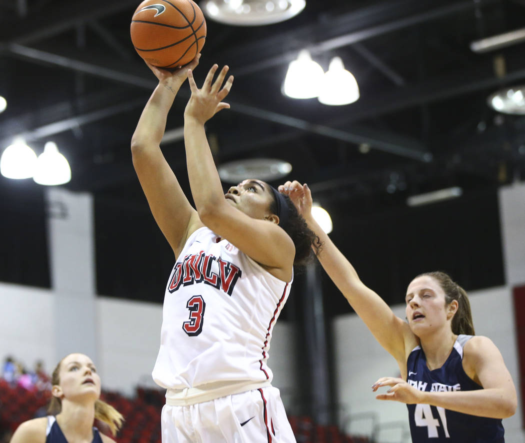 UNLV Lady Rebels forward/center Paris Strawther (3) goes to the basket past Utah State Aggies forward Taylor Franson (41) during the second half of a basketball game at the Cox Pavilion in Las Veg ...