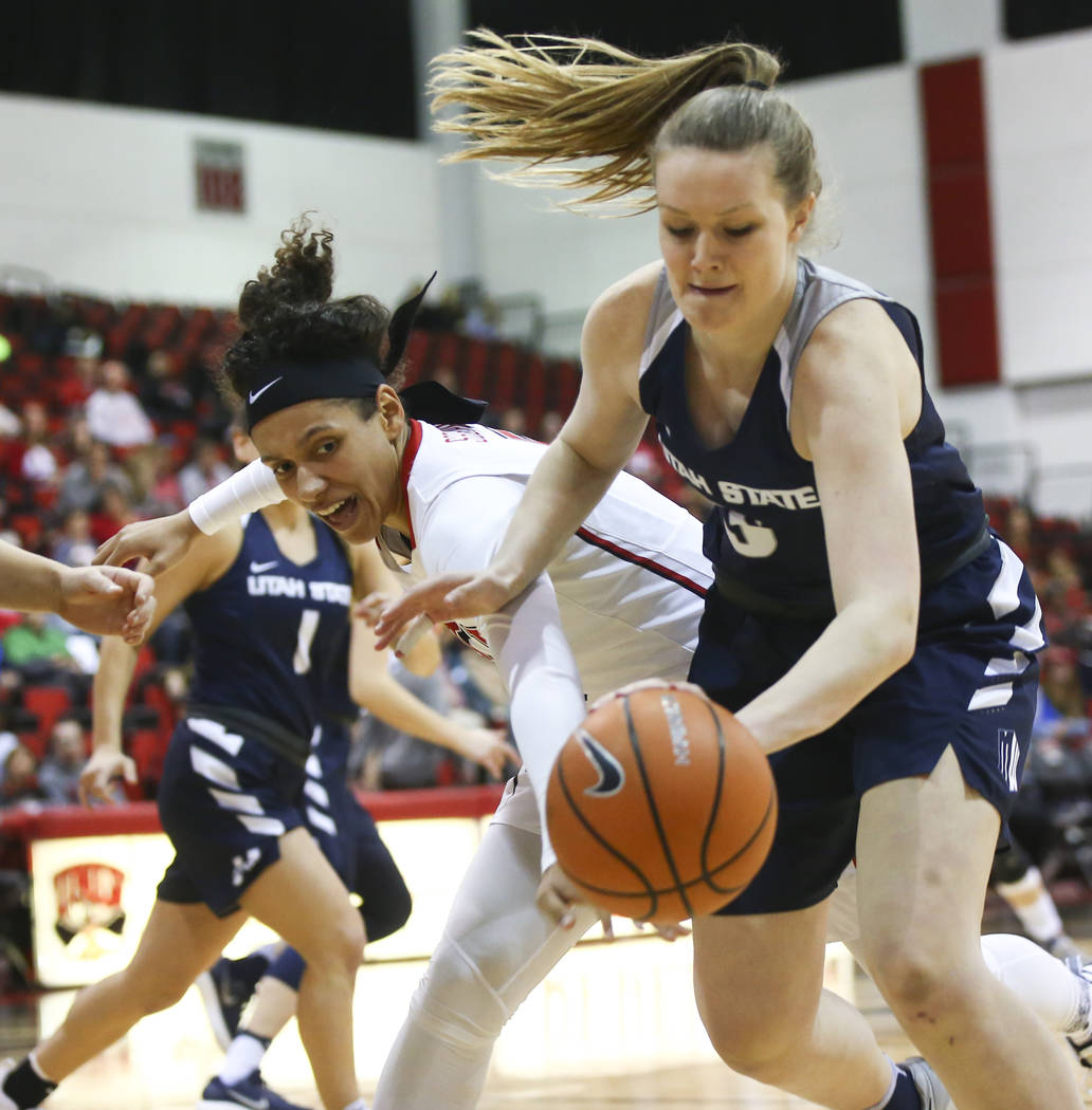 UNLV Lady Rebels forward Simone Sheppard (5) reaches for a loose ball against Utah State Aggies guard/forward Shannon Dufficy (5) during the first half of a basketball game at the Cox Pavilion in  ...