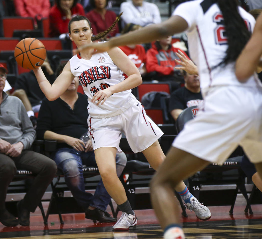 UNLV Lady Rebels forward Alyssa Anderson (20) passes the ball during the first half of a basketball game against the Utah State Aggies at the Cox Pavilion in Las Vegas on Friday, March 2, 2018. Ch ...