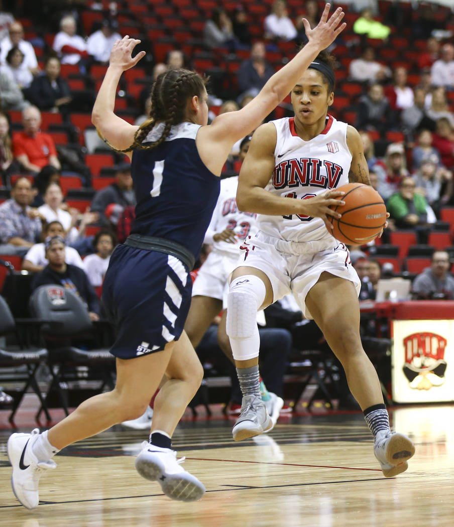 UNLV Lady Rebels guard Nikki Wheatley (10) drives against Utah State Aggies guard Eliza West (1) during the first half of a basketball game at the Cox Pavilion in Las Vegas on Friday, March 2, 201 ...