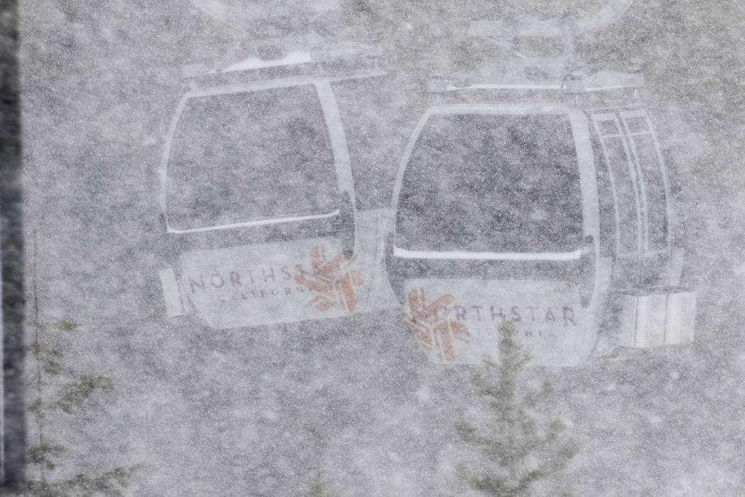 In this photo provided by Northstar California, large snowflakes obscure a pair of gondolas as a storm passes Thursday, March 1, 2018, at the Northstar California resort in Truckee, Calif. A major ...