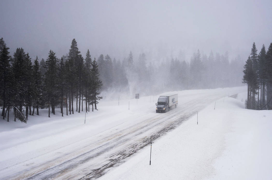 A truck heads west through the snow on Interstate 80, Thursday, March 1, 2018, near Donner Summit, Calif. A major winter storm swept south through California on Thursday, bringing heavy snow and s ...