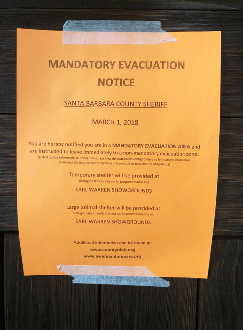 Deputies have placed a notice on a home near Carpinteria, Calif., advising of the mandatory evacuation due to forecast rain and possible debris flow due to the recent Thomas Fire Thursday, March 1 ...