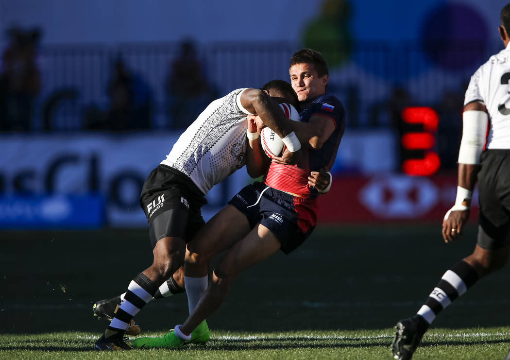 Vasikali Mudu, left, of Fiji collides with Ilya Babaev of Russia during day one of the USA Sevens Rugby tournament at Sam Boyd Stadium in Las Vegas on Friday, March 2, 2018. Babaev was taken on th ...