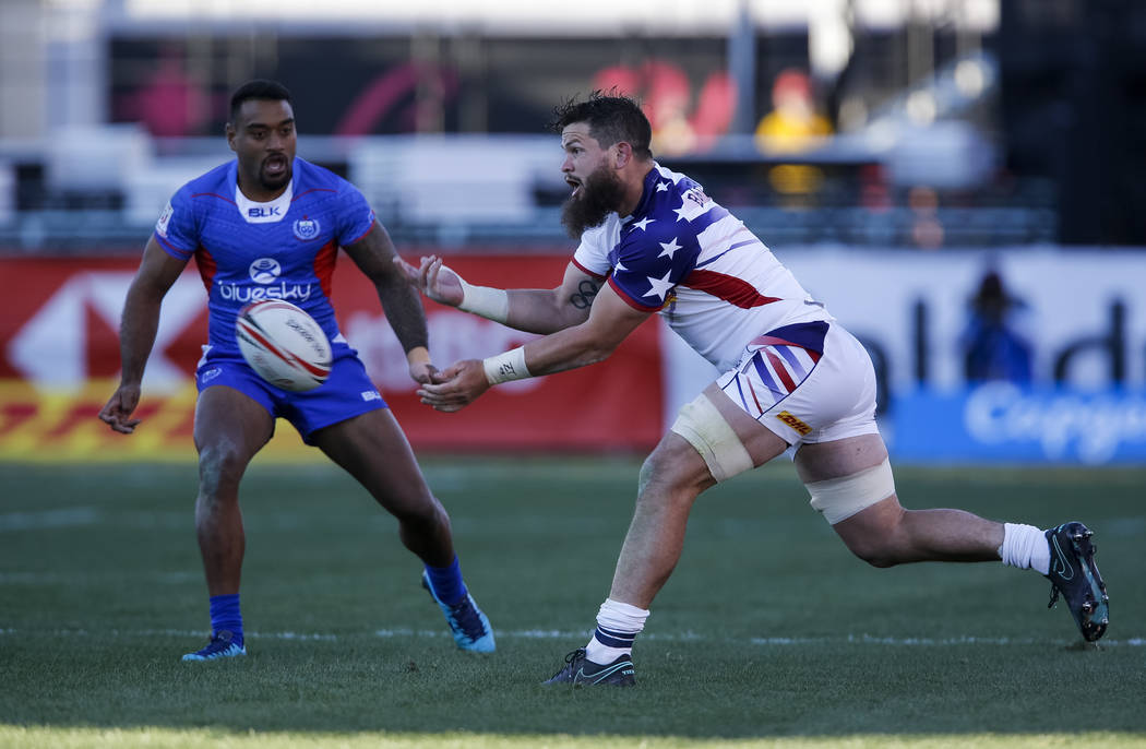 Danny Barrett of the US passes the ball against Samoa during day one of the USA Sevens Rugby tournament at Sam Boyd Stadium in Las Vegas on Friday, March 2, 2018. Richard Brian Las Vegas Review-Jo ...